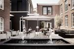 Cafeneaua cochetă din curtea fostei închisori Het Arresthuis